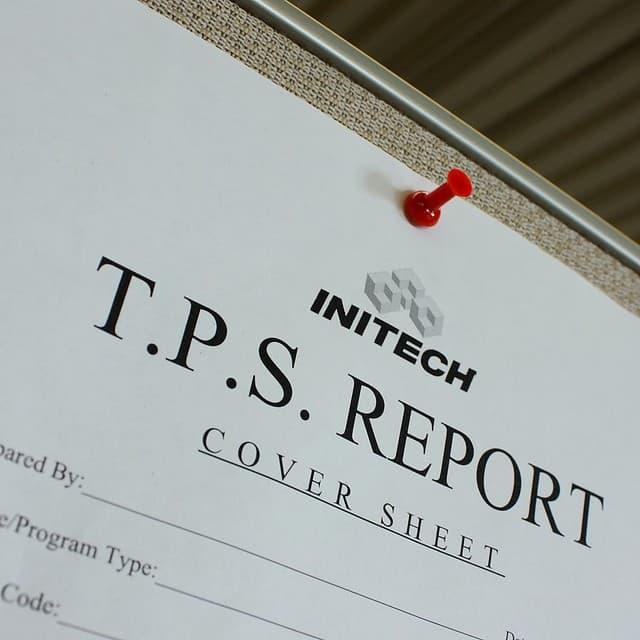 report sheet with pushpin on corkboard