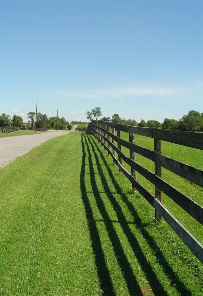 long rail fence along road