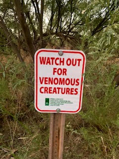 venomous creatures warning sign